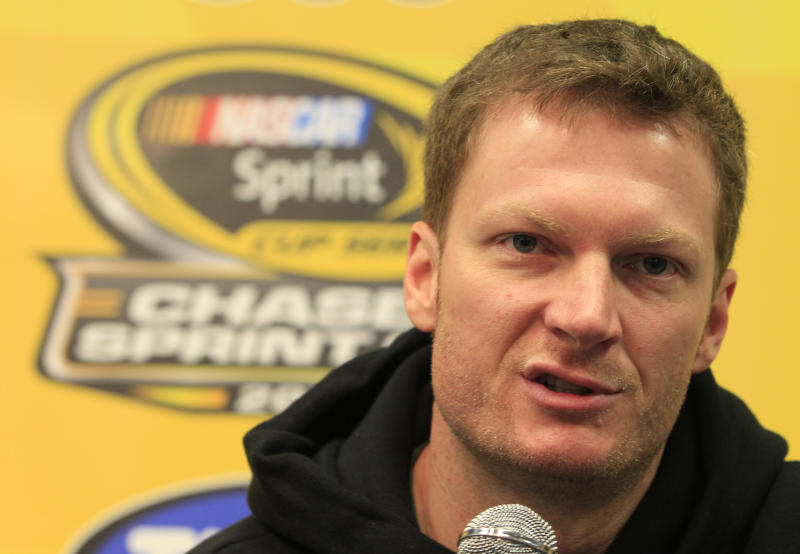 Dale Earnhardt Jr., speaks during a news conference prior to his first practice since recovering from concussions at Martinsville Speedway in Martinsville, Va., Friday, Oct. 26, 2012. (AP Photo/Steve Helber)
