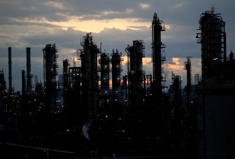 Steam is emitted from factories at sunset in Keihin industrial zone in Kawasaki