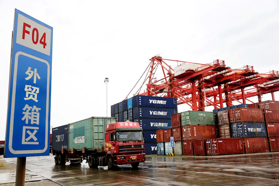 A truck transports containers at a container terminal in Lianyungang, east China's Jiangsu Province, July 13, 2021. China's foreign trade in the first half of the year posted the best performance in history, underpinned by the country's sustainable economic recovery and strong global demand. The country's foreign trade rose 27.1 percent year on year to 18.07 trillion yuan about 2.79 trillion U.S. dollars in the first six months, showed data from the General Administration of Customs GAC on Tuesday. (Photo by Wang Chun/Xinhua via Getty Images)