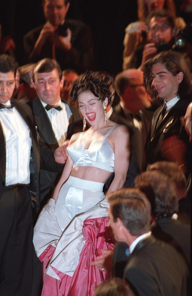 <p>Madonna wore a bralet version of her cone corset on the red carpet in Cannes in 1991, making one memorable appearance. <em>[Photo: Getty]</em> </p>
