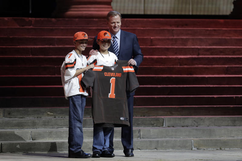 NFL commissioner Roger Goodell, right, poses with Cleveland Browns' fans during last year's NFL draft. (AP)