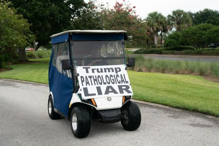 Ed McGinty, a 71-year old retiree from Philadelphia, is staging a daily protest against President Donald Trump and is seen in Orlando, Florida on July 23, 2020