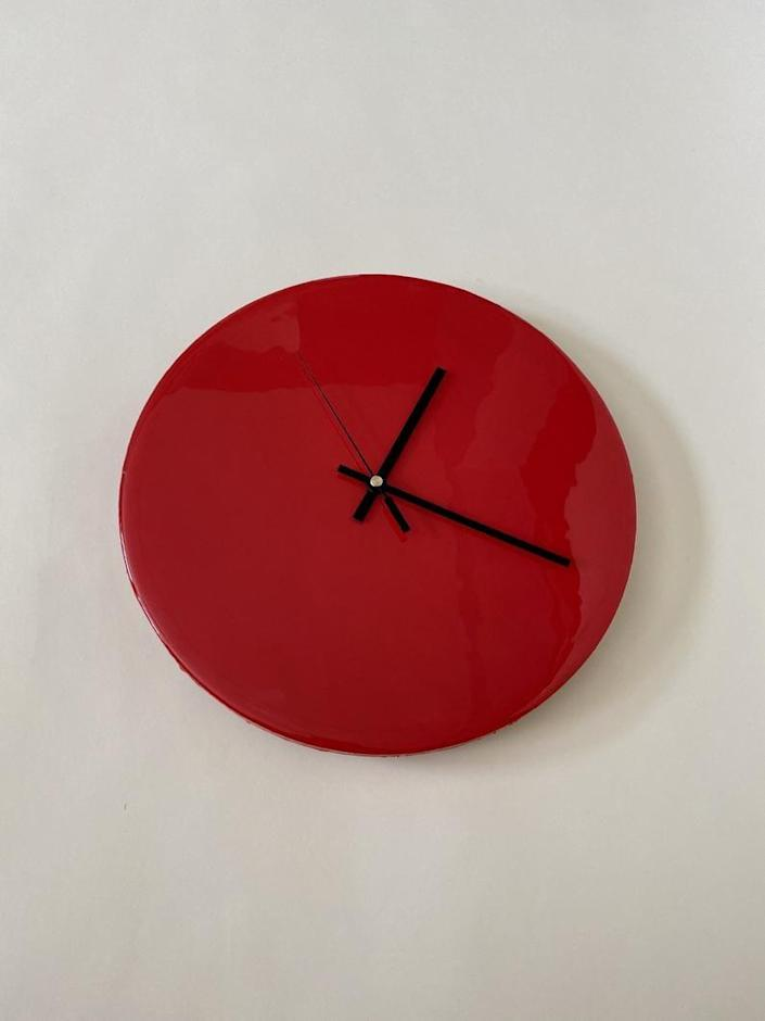 """The only thing better than a chic lacquered wall clock is a chic lacquered wall clock you can customize! Choose between four different hand styles and six distinct colors for a clock that's all your own. It measures 12 inches in diameter. $125, Etsy. <a href=""""https://www.etsy.com/listing/840167909/modern-round-clock-lacquered-luxury-home"""" rel=""""nofollow noopener"""" target=""""_blank"""" data-ylk=""""slk:Get it now!"""" class=""""link rapid-noclick-resp"""">Get it now!</a>"""