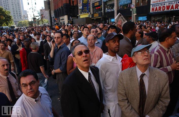 """Getty photographer Spencer Platt's picture of a crowd in Lower Manhattan watching the twin towers burn captures, in one instant, the profound disbelief that held sway in the city and around the world -- a disbelief that inevitably turned to mingled rage, grief, and fear as the scale and the nature of the attack on the country gradually became clear. Here, in a sense, is a portrait of the terrorists' true target: young and old, men and women, civilians of countless races and, no doubt, countless creeds who were, mysteriously, spared, only to bear witness. <br><br>(Photo: Spencer Platt/Getty Images)<br><br>For the full photo collection, go to <a href=""""http://www.life.com/gallery/59971/911-the-25-most-powerful-photos#index/0"""" rel=""""nofollow noopener"""" target=""""_blank"""" data-ylk=""""slk:LIFE.com"""" class=""""link rapid-noclick-resp"""">LIFE.com</a>"""
