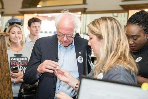 Democratic presidential candidate Bernie Sanders joins a diabetes patient at a pharmacy on a trip to Canada for affordable insulin on July 28, 2019 in Windsor, Canada