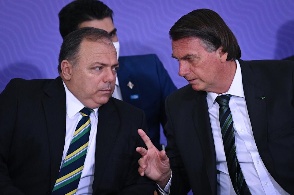 Brazil's president Jair Bolsonaro speaks with Brazil's Health Minister Eduardo Pazuello during the launching ceremony of the National Vaccination Operationalization Plan against COVID-19 at Planalto Palace in Brasilia, Brazil, on Wednesday, Dec. 16, 2020. (Photo by Andre Borges/NurPhoto via Getty Images)