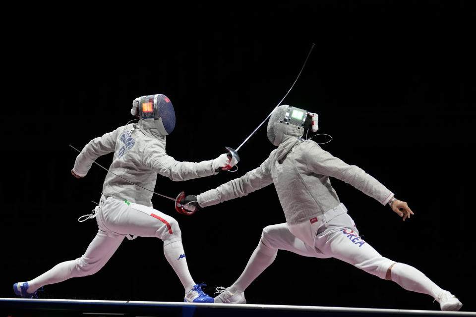 Aldo Montano of Italy, left, and Oh Sanguk of South Korea compete in the men's Sabre team medal at the 2020 Summer Olympics, Wednesday, July 28, 2021, in Chiba, Japan. (AP Photo/Andrew Medichini)