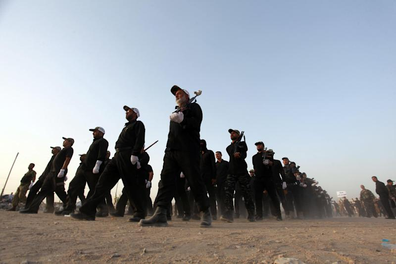 Newly-recruited Iraqi volunteers take part in a training session on June 20, 2014