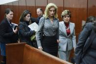 """FILE — In this Dec. 5, 2017, file photo, attorney Gloria Allred, right, and Summer Zervos, second from right, leave a courtroom after a hearing in Manhattan State Supreme court for a defamation lawsuit filed by Zervos against President Donald Trump, in New York. Former President Donald Trump now has a Dec. 23 deadline to undergo questioning in a former """"Apprentice"""" contestant's defamation lawsuit over what he said in denying her sexual assault allegations, a court said Monday, Oct. 4, 2021. (Barry Williams/Pool via AP, File)"""