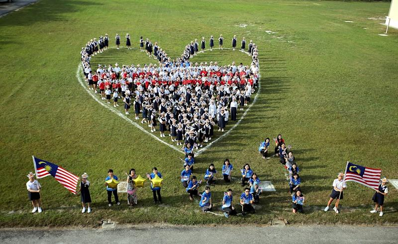 297 students and 35 teachers from SJK Min Sin made a heart shape formation to show their love for the nation, in Ipoh August 27, 2018. — Picture by Farhan Najib