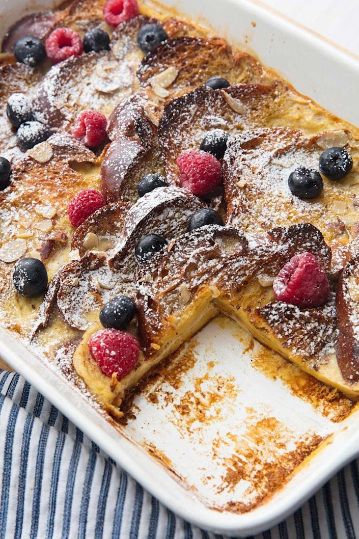 """<p>French toast for a crowd — with no dirty pans in sight!</p><p>Get the recipe from <a href=""""https://www.delish.com/cooking/recipe-ideas/a20138091/easy-french-toast-casserole-recipe/"""" rel=""""nofollow noopener"""" target=""""_blank"""" data-ylk=""""slk:Delish.com"""" class=""""link rapid-noclick-resp"""">Delish.com</a>. </p>"""