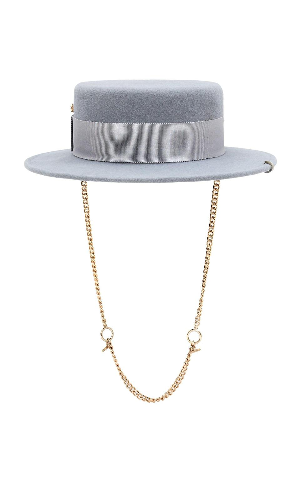 """<p><strong>Ruslan Baginskiy Hats</strong></p><p>modaoperandi.com</p><p><strong>$380.00</strong></p><p><a href=""""https://go.redirectingat.com?id=74968X1596630&url=https%3A%2F%2Fwww.modaoperandi.com%2Fruslan-baginskiy-hats-pf20%2Fpiercing-canotier-hat&sref=https%3A%2F%2Fwww.oprahmag.com%2Fstyle%2Fg33275493%2Ffall-hats-for-women%2F"""" rel=""""nofollow noopener"""" target=""""_blank"""" data-ylk=""""slk:Shop Now"""" class=""""link rapid-noclick-resp"""">Shop Now</a></p><p>It's a huge splurge, but this pale blue-grey hat from Ukrainian milliner Ruslan Baginskiy hits all the right style notes (""""chain details were all over the runways,"""" according to Nazzaro) and will have people asking where you got it for years to come. Think of it as a (big) investment piece.</p>"""