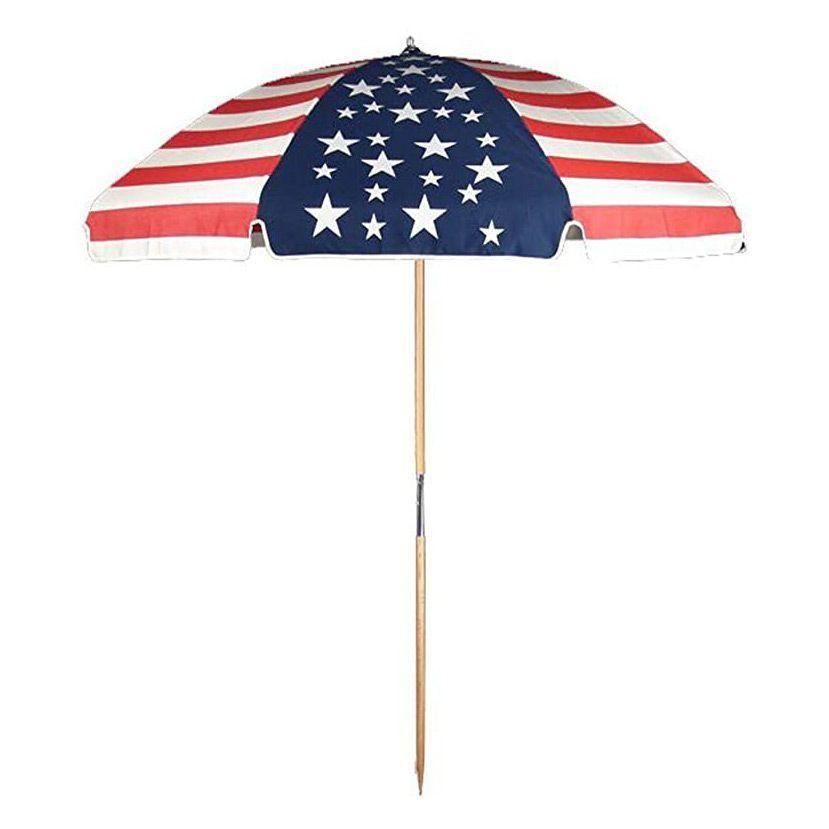 """<p><strong>Frankford Umbrellas</strong></p><p>amazon.com</p><p><strong>$239.90</strong></p><p><a href=""""https://www.amazon.com/dp/B011J2ZCPA?tag=syn-yahoo-20&ascsubtag=%5Bartid%7C10055.g.31744593%5Bsrc%7Cyahoo-us"""" rel=""""nofollow noopener"""" target=""""_blank"""" data-ylk=""""slk:Shop Now"""" class=""""link rapid-noclick-resp"""">Shop Now</a></p><p>For the ultimate beach umbrella, this style from Frankford Umbrellas features thick acrylic fabric designed to be durable season after season. It's <strong>available in 22 colors and patterns, including stripes and including an American flag, perfect for July 4th weekend</strong>. Unlike other styles, this umbrella has a stylish wood pole with a spike to secure into the sand. There's an included carrying case, but note that this luxury umbrella is heavier than other picks.</p>"""