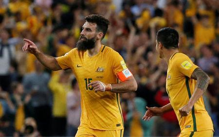 Australia's Mile Jedinak celebrates scoring a goal. REUTERS/Steve Christo
