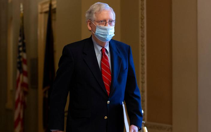 Mitch McConnell walks from his office to the Senate floor on Capitol Hill - Michael Reynolds/Shutterstock