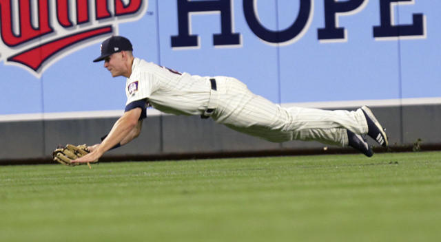 Minnesota Twins' Max Kepler makes a diving catch on a ball hit by Boston Red Sox's J.D. Martinez during the eighth inning of a baseball game Wednesday, June 20, 2018, in Minneapolis. The Twins defeated the Red Sox 4-1. (AP Photo/Andy Clayton-King)