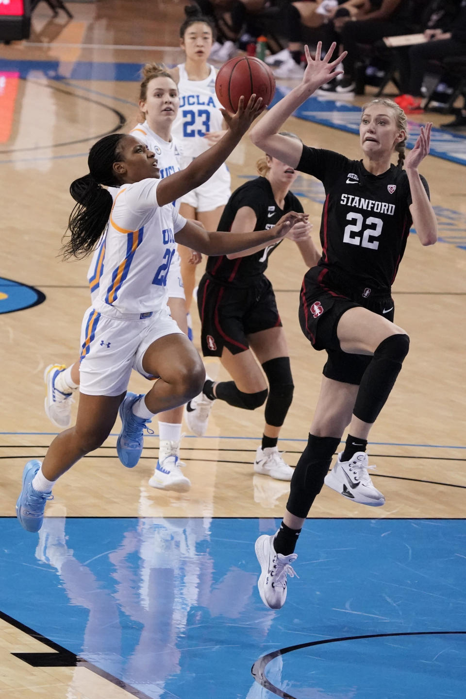 UCLA guard Charisma Osborne, left, drives to the basket as Stanford forward Cameron Brink (22) defends during the second half of an NCAA college basketball game Monday, Dec. 21, 2020, in Los Angeles. (AP Photo/Marcio Jose Sanchez)