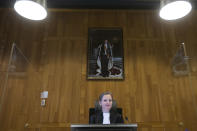 Judge Larisa Alwin opens the court case of Milieudefensie, the Dutch arm of the Friends of the Earth environmental organization, against Shell in The Hague, Netherlands, Tuesday, Dec. 1, 2020. A landmark legal battle opened as climate change activists in the Netherlands go to court seeking an order for energy giant Shell to rein in its carbon emissions. (AP Photo/Peter Dejong, Pool)