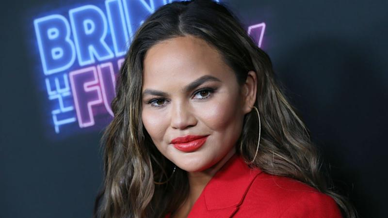 Chrissy Teigen Claps Back at Commenter for Criticizing a Firefighter Who Posed With Her Kids