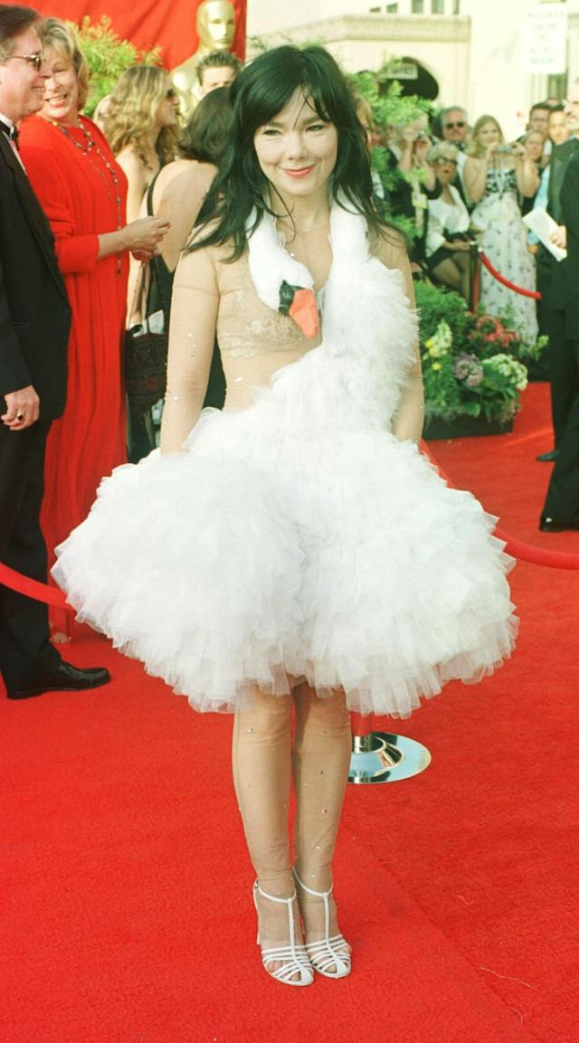 <p>Created by designer Marjan Pejoski, the infamous dress was designed like a swan, and at the ceremony in 2001, Björk mimicked laying an egg on the red carpet. (Photo: PA) </p>
