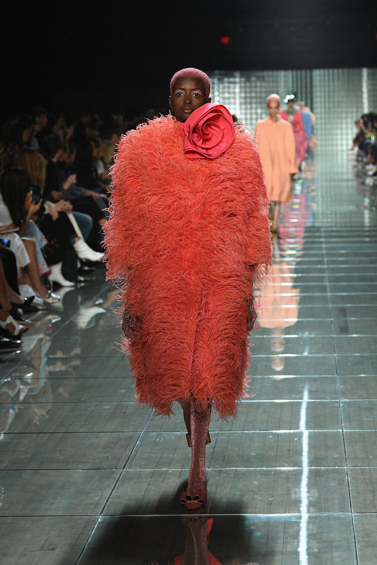 The designer also went bold with this bright feathered coat.