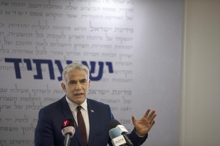 Yesh Atid party leader Yair Lapid speaks to journalists at the Knesset, Israel's Parliament, Monday, June 7, 2021. (AP Photo/Maya Alleruzzo, Pool)