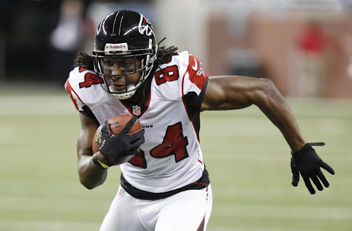 Atlanta Falcons wide receiver Roddy White runs for a 39-yard touchdown during the second quarter of an NFL football game against the Detroit Lions at Ford Field in Detroit, Saturday, Dec. 22, 2012. (AP Photo/Duane Burleson)