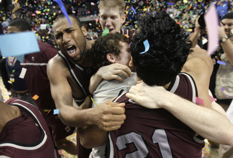 Arkansas-Little Rock's Marlon Louzeiro, facing camera, celebrates with his teammates after the Sun Belt tournament championship NCAA college basketball game in Hot Springs, Ark., Tuesday, March 8, 2011. Arkansas-Little Rock defeated North Texas 64-63. (AP Photo/Danny Johnston)