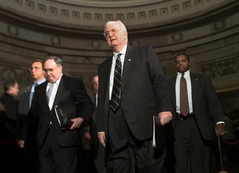 House Judiciary Committee Chairman Rep. Henry Hyde, R-Ill., center, accompanied by committee counsel Thomas Mooney, left, and other Republican committee members, walks to the Senate Chamber on Capitol Hill Thursday Jan. 7, 1999 to deliver his committee's articles of impeachment against President Clinton. (Photo: Khue Bui)/AP