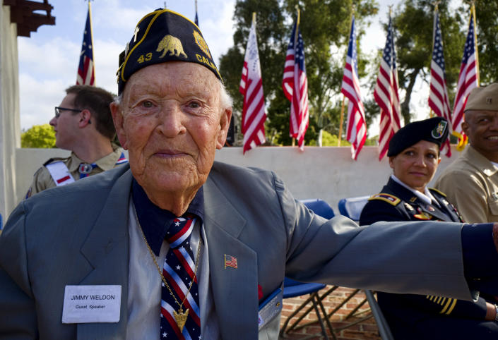 <p>WWII veteran Jimmy Weldon poses for a photo during a ceremony at the Los Angeles National Cemetery on Saturday, May 26, 2018. (Photo: Richard Vogel/AP) </p>