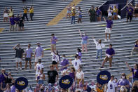 A limited number of fans in the student section, seated according to COVID-19 restrictions requiring social distancing and masks, watch in the first half an NCAA college football game between LSU and Mississippi State in Baton Rouge, La., Saturday, Sept. 26, 2020. Mississippi State won 44-34. (AP Photo/Gerald Herbert)