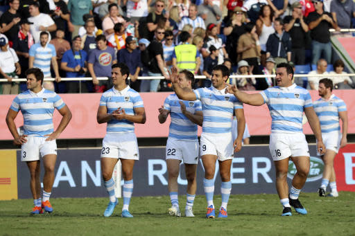 Argentina's players greet spectators after the Rugby World Cup Pool C game at Kumagaya Rugby Stadium between US and Argentina in Kumagaya, Japan, Saturday, Oct. 9, 2019. (AP Photo/Eugene Hoshiko)