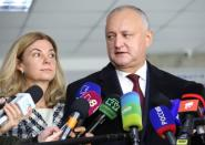 Igor Dodon, Moldova's President and presidential candidate, and his wife Galina visit a polling station during the second round of a presidential election in Chisinau