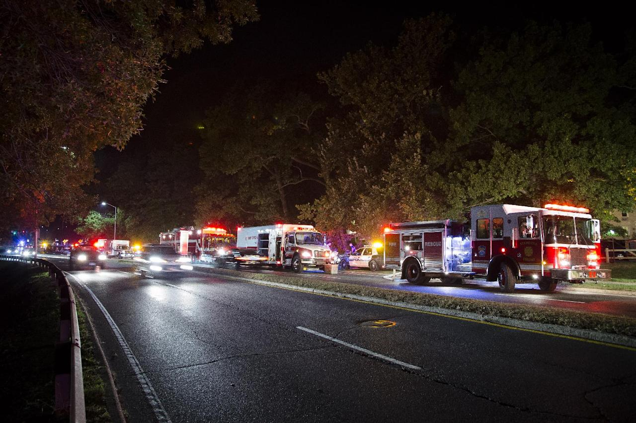 Emergency response vehicles wait outside the apartment complex where Miriam Carey is believed to have lived in Stamford, Conn. Thursday, Oct. 3, 2013. Law-enforcement authorities have identified Carey, 34, as the woman who, with a 1-year-old child in her car, led Secret Service and police on a harrowing chase in Washington from the White House past the Capitol Thursday, attempting to penetrate the security barriers at both national landmarks before she was shot to death, police said. The child survived. (AP Photo/John Minchillo)