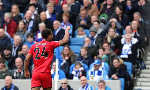 Steve Mounié celebrates scoring Huddersfield's equalising goal following Shane Duffy's misplaced backpass.