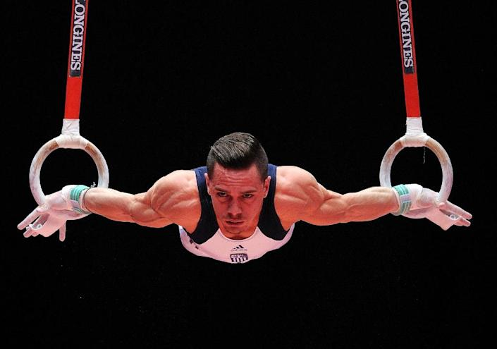 Greek gymnast Eleftherios Petrounias performs on the rings during day one of the Women and Men's Apparatus Final at the 2015 World Gymnastics Championships in Glasgow, Scotland, on October 31, 2015 (AFP Photo/Andy Buchanan)