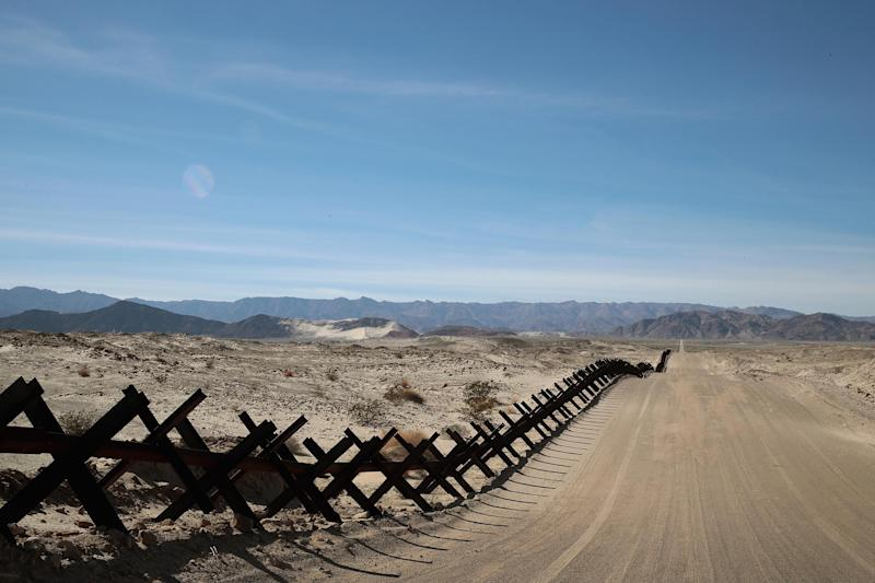 A steel barrier runs along the border of the United States and Mexico on January 26, 2019 near Calexico, California.