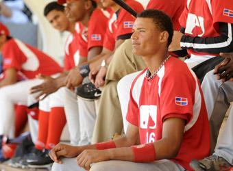 Jairo Beras of the Dominican Republic sits in the dugout during the MLB talent showcase