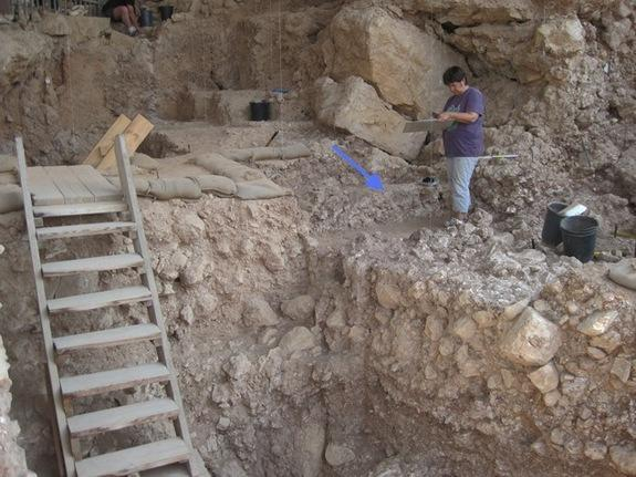 An arrow points to the Qesem Cave hearth, where hominins may have tended to fires as early as 300,000 years ago.