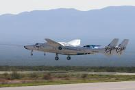 Virgin Galactic's passenger rocket plane VSS Unity takes off with carrier jet at Spaceport America