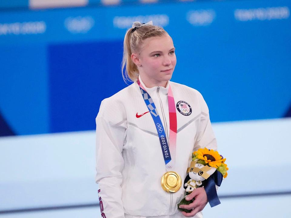 Carey poses with her gold medal after the floor exercise final.