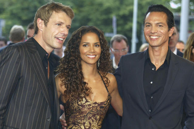 "<p>Although the movie failed to wow crowds and bring in big box-office numbers, Berry, seen here with co-stars Lambert Wilson and Benjamin Bratt, was a good sport about it. She even attended the Razzies in person to pick up her trophy, <a href=""http://www.mtv.com/news/1497569/halle-berry-slams-catwoman-at-razzie-awards/"" rel=""nofollow noopener"" target=""_blank"" data-ylk=""slk:saying in her acceptance speech,"" class=""link rapid-noclick-resp"">saying in her acceptance speech,</a> ""I want to thank Warner Bros. for casting me in this piece-of-s***, god-awful movie.""<br> (Photo: Getty Images) </p>"