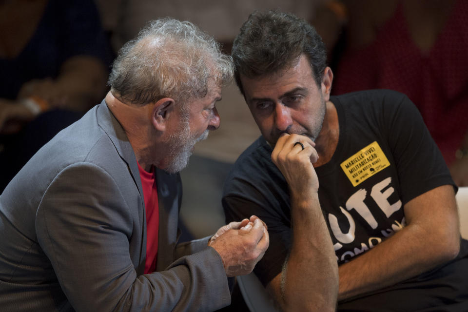 Former Brazilian president (2003-2011) Luiz Inacio Lula da Silva (L) speaks with Marcelo Freixo (R), Rio de Janeiro state deputy for the Socialism and Liberty Party (PSOL) during a rally of Brazilian leftist parties at Circo Voador in Rio de Janeiro, Brazil, on April 02, 2018.  The chief justice of Brazil's Supreme Court urged calm and warned against violence Monday ahead of a ruling that could send former president Luiz Inacio Lula da Silva to prison -- or give him a get-out-of-jail card. / AFP PHOTO / Mauro Pimentel        (Photo credit should read MAURO PIMENTEL/AFP via Getty Images)