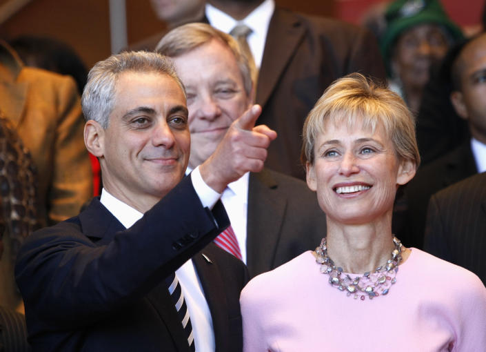 FILE - In this May 16, 2011, file photo, Chicago Mayor-elect Rahm Emanuel, left, and his wife, Amy Rule, look out into the crowd during his inaugural ceremony in Chicago. Emanuel, a Democratic congressman and chief of staff to President Barack Obama before becoming mayor in 2011, announced Tuesday, Sept. 4, 2018, that he won't seek a third term in 2019. (AP Photo/Charles Rex Arbogast, File)
