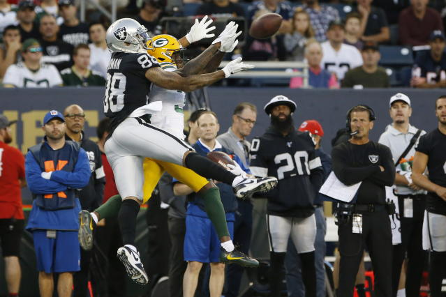 Oakland Raiders' Marcell Ateman (88) goes up for a pass as Green Bay Packers' Chandon Sullivan defends during the first half of an NFL preseason football game Thursday, Aug. 22, 2019, in Winnipeg, Manitoba. (John Woods/The Canadian Press via AP)