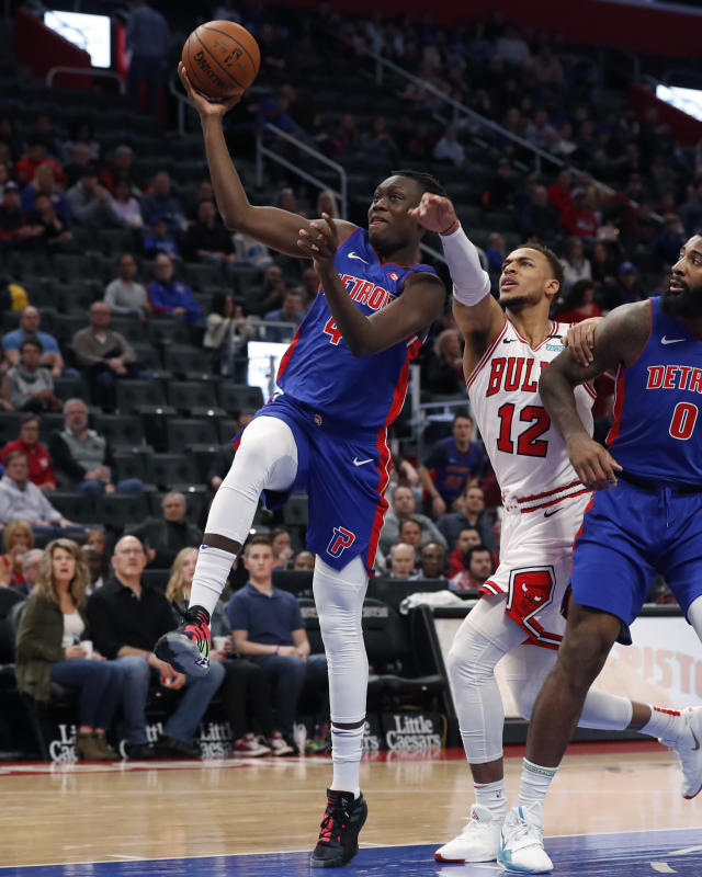 Detroit Pistons forward Sekou Doumbouya (45) makes a layup as Chicago Bulls forward Daniel Gafford (12) reaches in during the first half of an NBA basketball game, Saturday, Jan. 11, 2020, in Detroit. (AP Photo/Carlos Osorio)