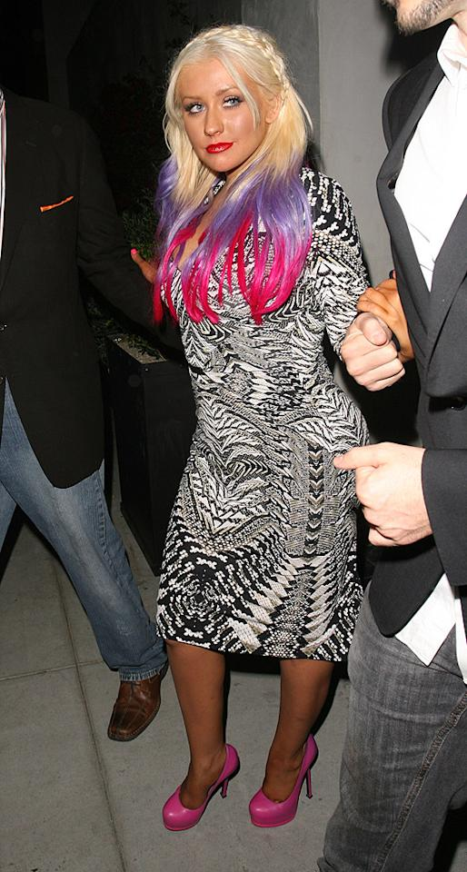 """Unfortunately, we don't think Christina Aguilera was giving her Jem and the Holograms Halloween costume a trial run while dining at Spago late last week. She just happens to look like an '80s cartoon character on a daily basis.<br>(9/28/2012)<br><br><a target=""""_blank"""" href=""""http://music.yahoo.com/blogs/reality-rocks/christina-aguilera-flaunts-killer-style-body-video-231535799.html"""">Watch Xtina's new music video, """"Your Body""""</a>"""