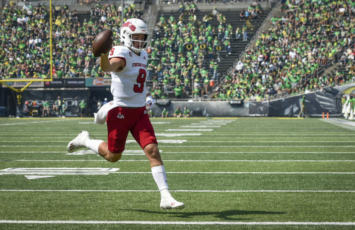 Fresno State quarterback Jake Haener (9) scores during the third quarter of an NCAA college football game against Oregon, Saturday, Sept. 4, 2021, in Eugene, Ore. (AP Photo/Andy Nelson)