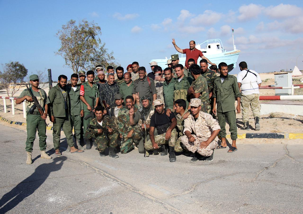 Members of the Libyan National Army poses for a photo next to Sidra oil port in Ras Lanuf, Libya June 21, 2018. Picture taken June 21, 2018. REUTERS/Stringer. NO RESALES. NO ARCHIVE