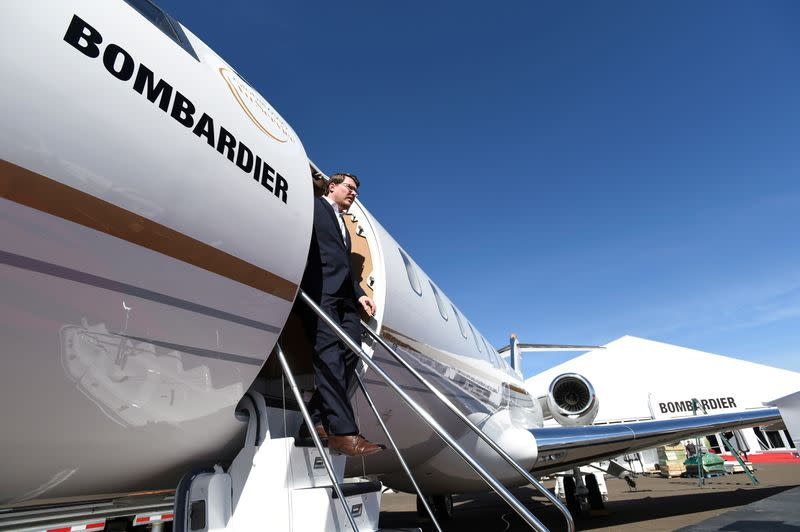 FILE PHOTO: Bombardier Aviation spokesperson Mark Masluch exits the Bombardier Global 6500 business jet at the National Business Aviation Association (NBAA) exhibition in Las Vegas